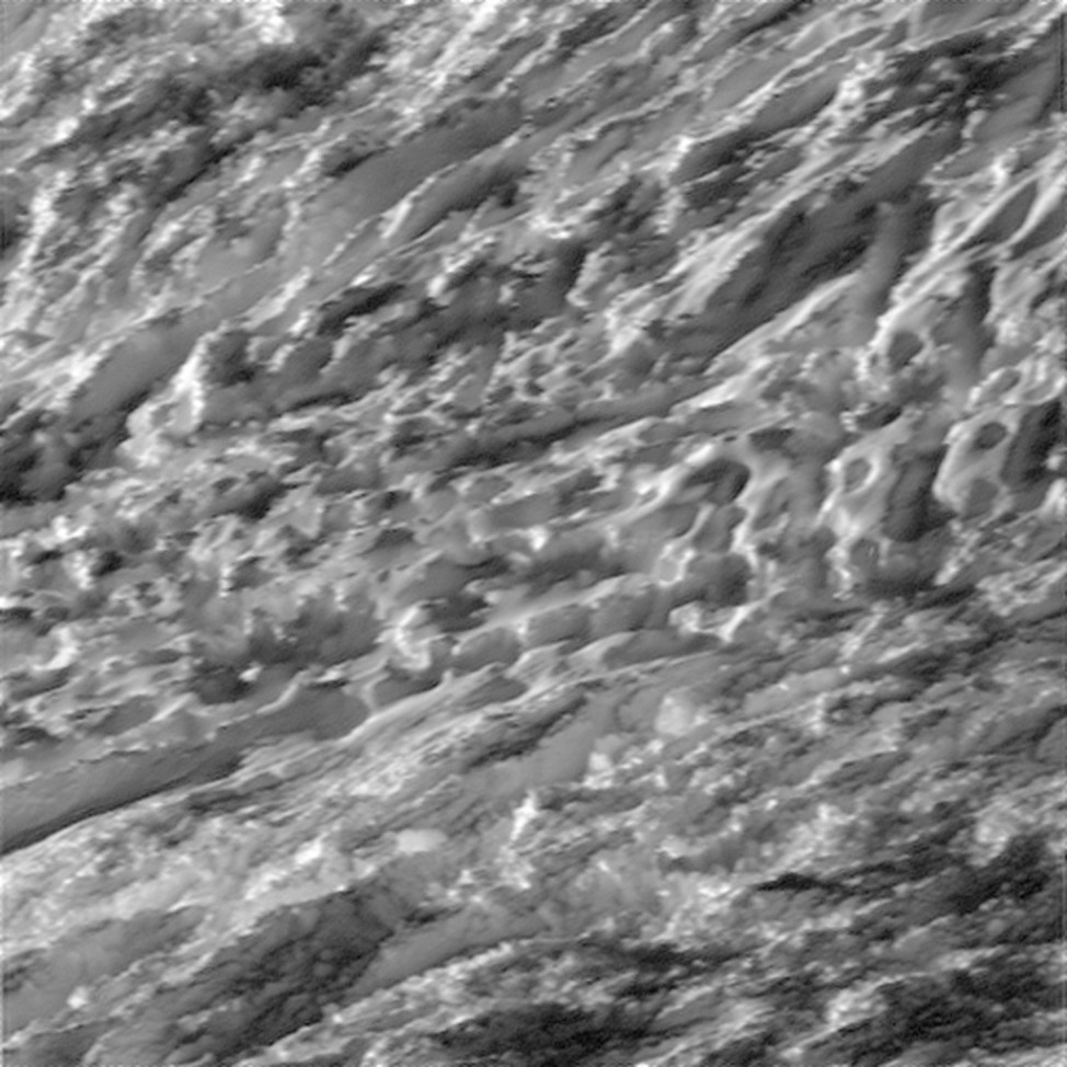 On 10/28/15 NASA's Cassini spacecraft flew close to the surface of Enceladus, one of Saturn's moons.  The spacecraft captured images of the moon's southern polar region. This image was taken in visible light with the Cassini spacecraft wide-angle camera from a distance of about 124 km above the moon's surface (NASA/JPL-Caltech/Space Science Institute)