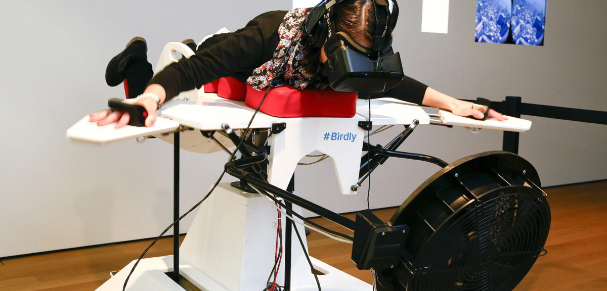 "A visitor tries the flight simulator 'Birdly' at the exhibition ""Animated Wonderworlds"" at Zurich's Museum for Design, 11/17/15. Birdly simulates the flight of a red kite over New York City, controlled by the entire body of the user. The flight simulator was developed by scientists at Zurich University of the Arts. (Reuters)"