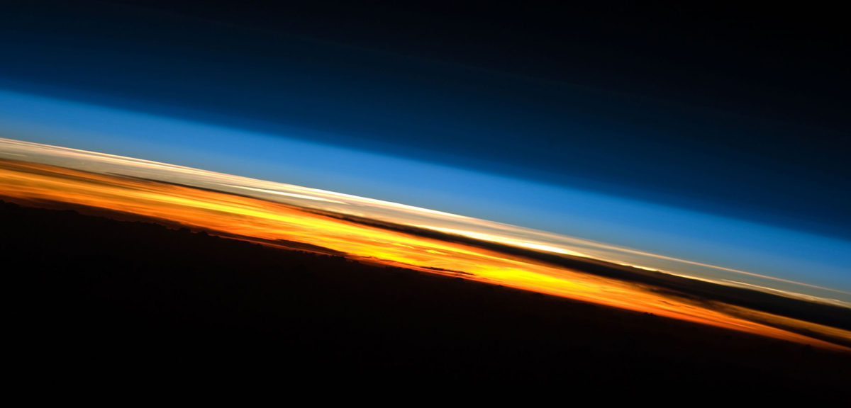 A view of Earth's atmosphere at sunset as seen by the International Space Station Expedition 23 crew in 2010. Colors here roughly denote the various layers of the atmosphere. (NASA)