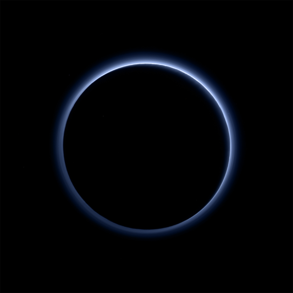 This image released by NASA on 10/8/15, shows the blue color of Pluto's haze layer in this picture taken by the New Horizons spacecraft's MVIC or Ralph/Multispectral Visible Imaging Camera. (NASA/JHUAPL/SwRI)