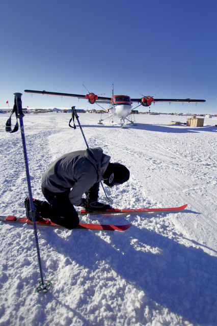 Refael Klein checks his bindings outside the Amundson-Scott South Pole Station. (Photo by Hunter Davis)