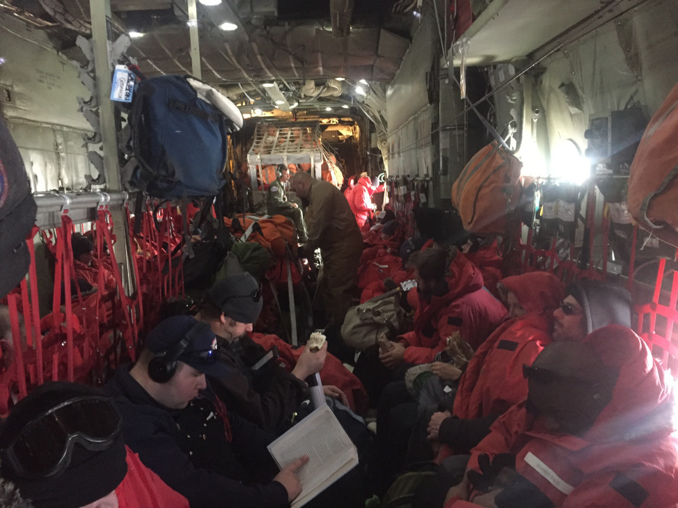 Cramped conditions inside the main cabin of the LC-130 en route to the South Pole. (Photo by Refael Klein)