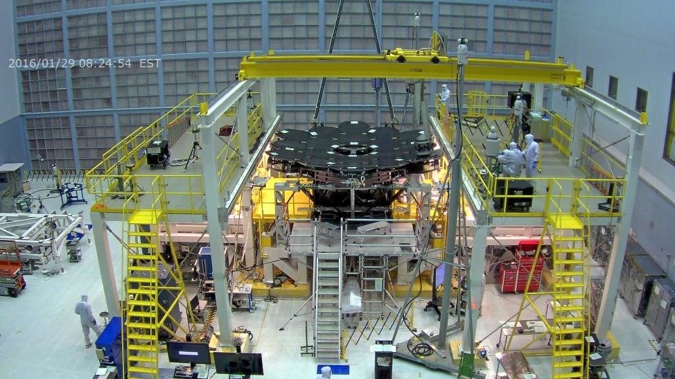 Webcam screen capture of technicians at NASA's Goddard Space Flight Center installing the 18th and final panel of the James West Space Telescope's 6.5 meter primary mirror on 1/29/16. (NASA/Goddard Space Flight Center)