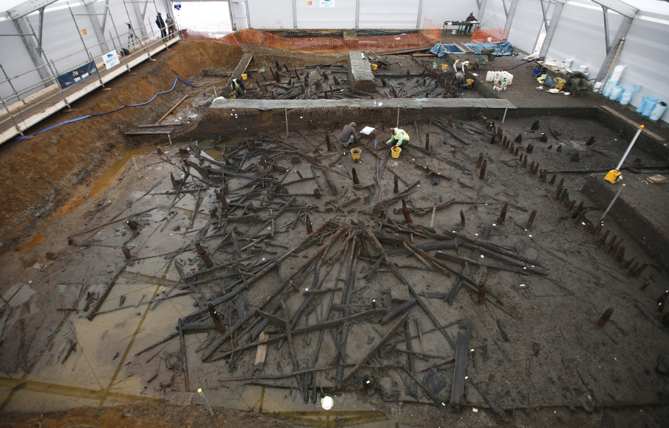 Scientists from the University of Cambridge Archaeological Unit, uncover remains of 3,000 year old wooden stilt houses on 1/12/16. The houses, said to be the best preserved Bronze Age dwellings ever found in Britain, were found preserved in silt, in a quarry. (Reuters)