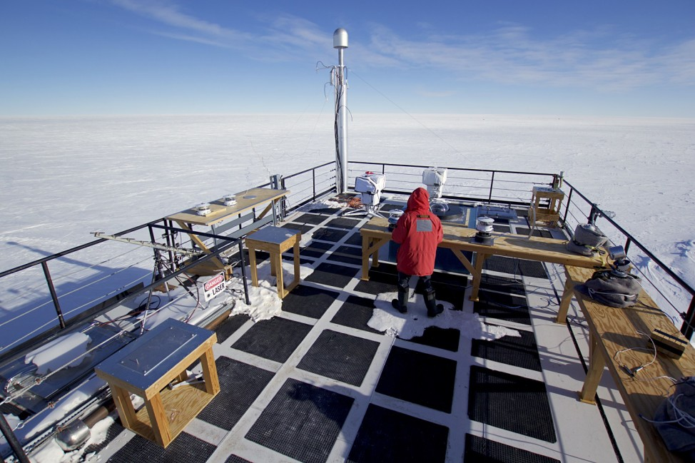 The author runs through daily checks on the solar radiation equipment at the Atmospheric Research Observatory (ARO) at the South Pole.  (Photo by Hunter Davis)