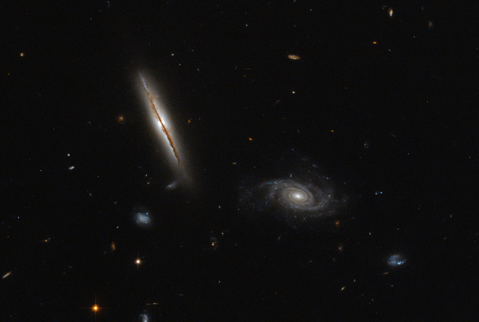 Released on 1/25/16, this is a Hubble Space Telescope image of two galaxies.  The one on the left-side is the edge of the LO95 0313-192 galaxy.  The spiral galaxy on the right-side is known as [LOY2001] J031549.8-190623. (ESA/Hubble & NASA)
