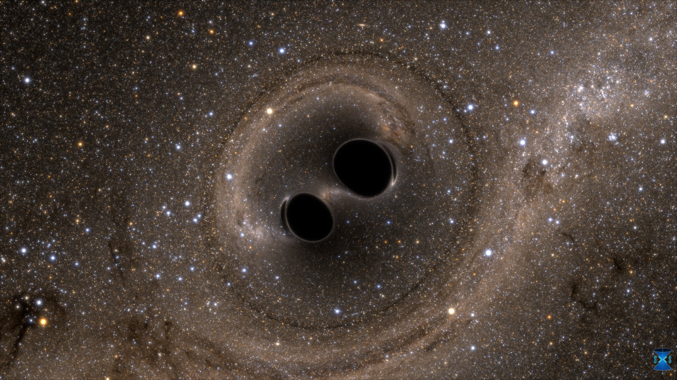 The collision of two black holes—an event detected for the first time ever by the Laser Interferometer Gravitational-Wave Observatory, or LIGO—is seen in this still from a computer simulation. (SXS)