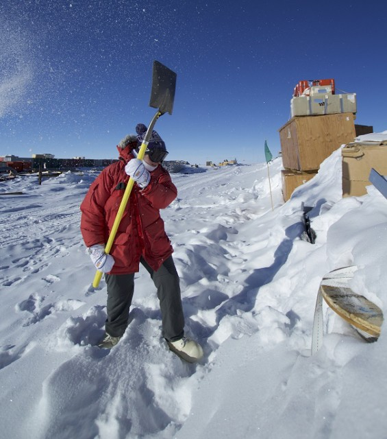 An endless task. A volunteer shovels snow off of a berm. (Photo by Hunter Davis)
