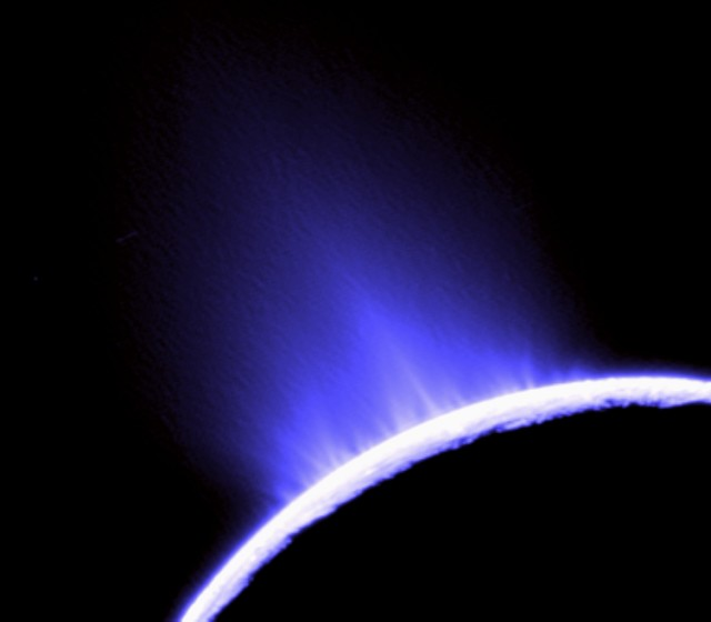 Ice geysers erupt on Enceladus, bright and shiny inner moon of Saturn. (Cassini Imaging Team, SSI, JPL, ESA, NASA)