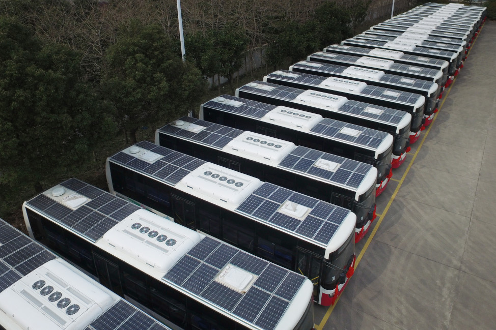 Buses with solar panels installed on their roofs to save electricity are seen in a parking lot in Hangzhou, Jiangsu Province, China, March 17, 2016. (Reuters)