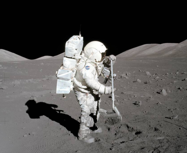 Apollo 17 astronaut Harrison H. Schmitt collects samples of lunar rocks and rock chips. Material gathered in this and other Apollo missions revealed presence of radioactive iron isotopes from a supernova explosion. (NASA)