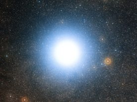 This wide-field view of the sky around the bright star Alpha Centauri was created from photographic images forming part of the Digitized Sky Survey 2. (European Southern Observatory)