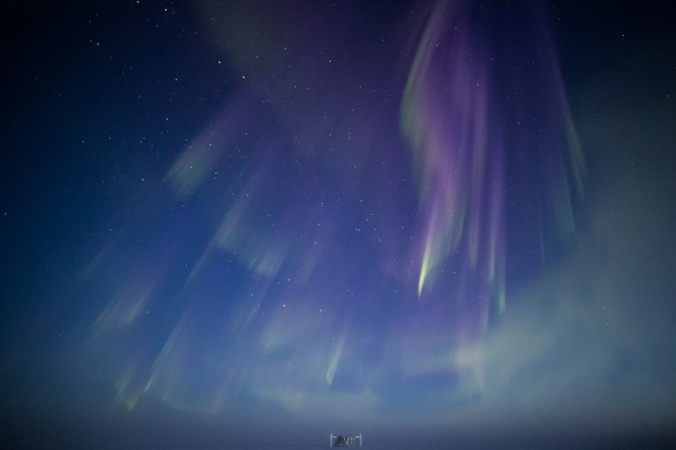 The first auroras of the season dance over the IceCube Neutrino Observatory a the South Pole. Long exposure and a steady hand are needed to capture them on film. (Photo by Hans Boenish)