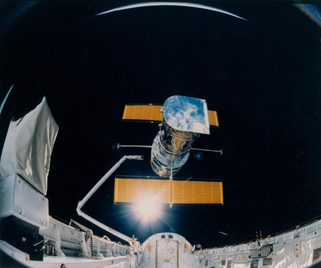 This photograph was taken by the STS-31 crew aboard the Space Shuttle Discovery and shows the Hubble Space Telescope being deployed on April 25, 1990, from the payload bay. (NASA)