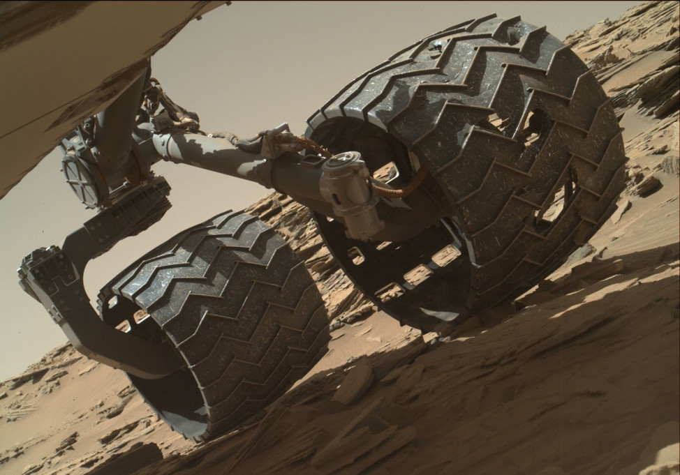 NASA's Mars rover Curiosity took a selfie on 4/18/16 that revealed some wear and tear on a couple of its left-middle and left-rear wheels. The traveling science laboratory has cruised about 12.7 kilometers over the Martian surface since touching down on 8/6/12. (NASA/JPL-Caltech/MSSS)