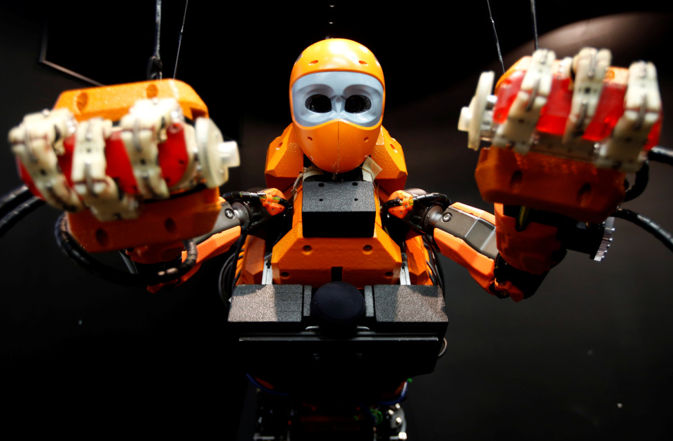 OceanOne's Humanoid Diving Robot, with a humanoid torso and a mermaid-like tail section is seen here during a presentation at the History Museum in Marseille, France on 4/28/16. The robot will eventually help with disaster relief, ship repair, oil and gas drilling, and other oceanographic research. (Reuters)