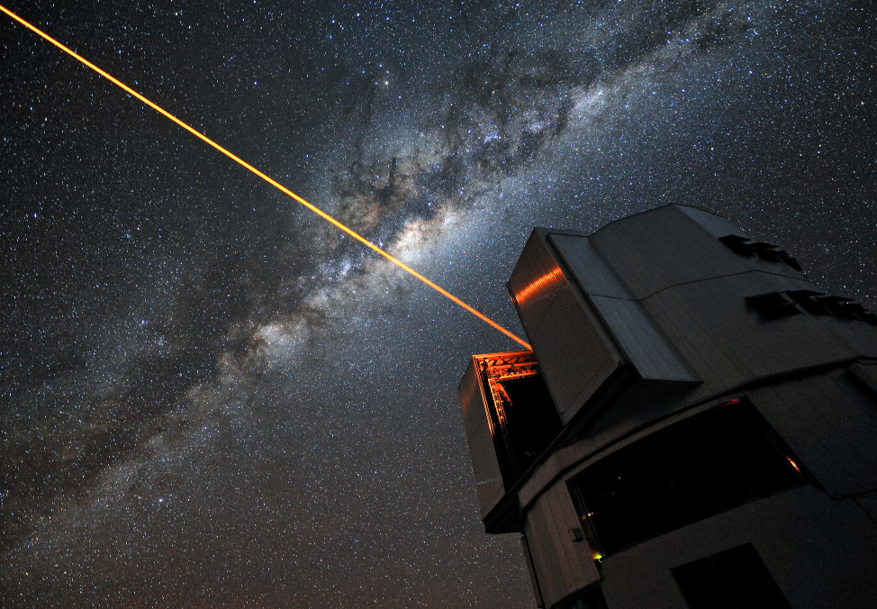 A 22W laser used for adaptive optics on the Very Large Telescope in Chile. A suite of similar lasers could be used to alter the shape of a planet's transit for the purpose of broadcasting or cloaking the planet. (ESO/G. Hüdepohl)