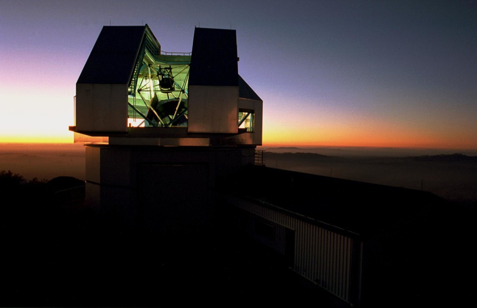 The WIYN telescope building at sunset. (NOAO/AURA/NSF)
