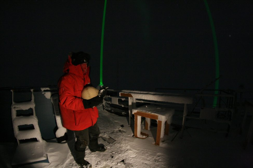 Multiple laboratories around the world work with NOAA to collect air samples. Above, Refael Klein collects an air sample for the Scripps Institute of Oceanography. (Photo by Daren Lukkari)