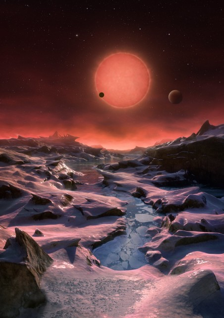 This artist's impression shows an imagined view from the surface one of the three planets orbiting an ultracool dwarf star just 40 light-years from Earth that were discovered using the TRAPPIST telescope at ESO's La Silla Observatory. (ESO/M. Kornmesser)
