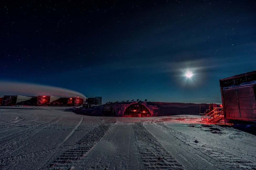 After weeks of darkness at the South Pole, a full moon seems nearly as bright as the sun. Details you couldn't see before, like vehicle tracks, become visible again. (Photo by Kyle Obrock)