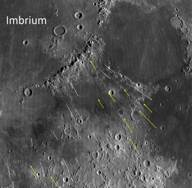 Grooves and gashes near the moon's Imbrium Basin have long stumped astronomers. New research examined these features to estimate the size of the object whose impact created this lunar feature. Researchers found that it was big enough to be considered a protoplanet. (NASA/Northeast Planetary Data Center/Brown University)