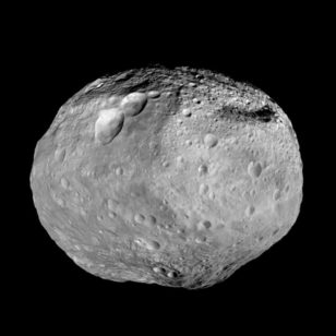 NASA's Dawn spacecraft photographed Vesta as it passed the dwarf planet on its trip to Ceres. (NASA/JPL-Caltech/UCAL/MPS/DLR/IDA)