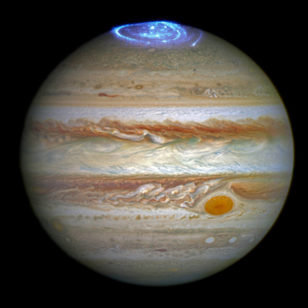 Astronomers are using NASA's Hubble Space Telescope to study auroras — stunning light shows in a planet's atmosphere — on the poles of the largest planet in the solar system, Jupiter. (NASA, ESA, and J. Nichols (University of Leicester))