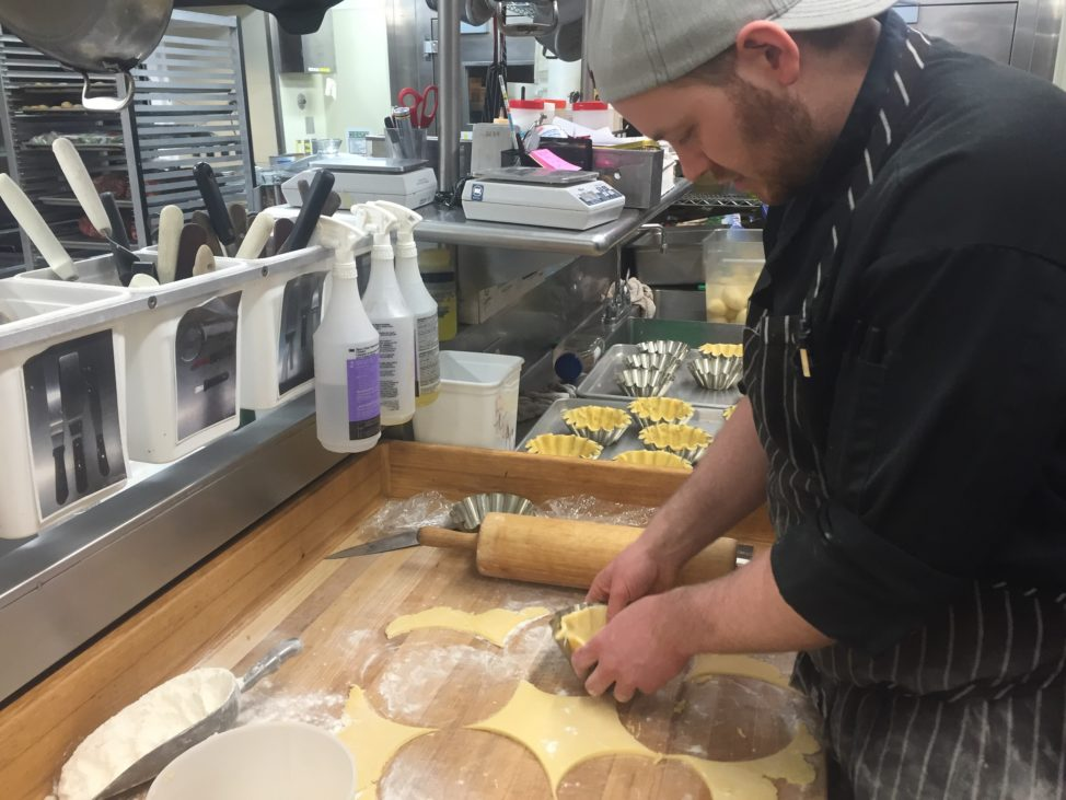 Busy at work, Chef KC Loosemore prepares shortbread pastry shells for his Peruvian Cocoa Nib Mousse Tarts. (Photo by Refael Klein)