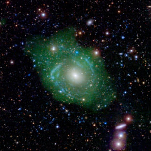 Say hello to the Frankenstein or UGC 1382 galaxy. Low density hydrogen gas shown in green (NASA/JPL)