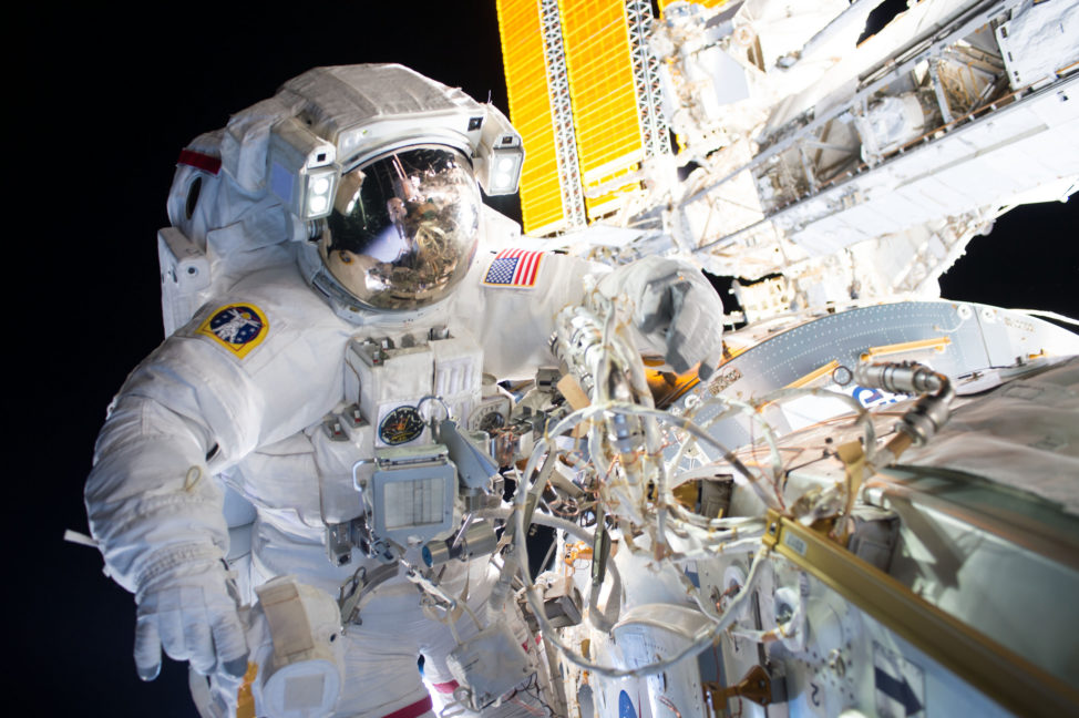 NASA astronauts Jeff Williams, who is shown here, along with crewmate Kate Rubins (who can be seen reflected in William's visor) successfully installed a new international docking adapter 8/19/16 during a five hour and 58-minute spacewalk. (NASA)