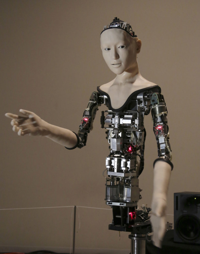 "The humanoid robot, ""Alter,"" is displayed at the National Museum of Emerging Science and Innovation in Tokyo. The robot features human-like movements of arms, fingers, the upper torso, its head as well as facial expressions. The exhibition runs until 8/6/16 in Tokyo. (AP Photo/Koji Sasahara)"