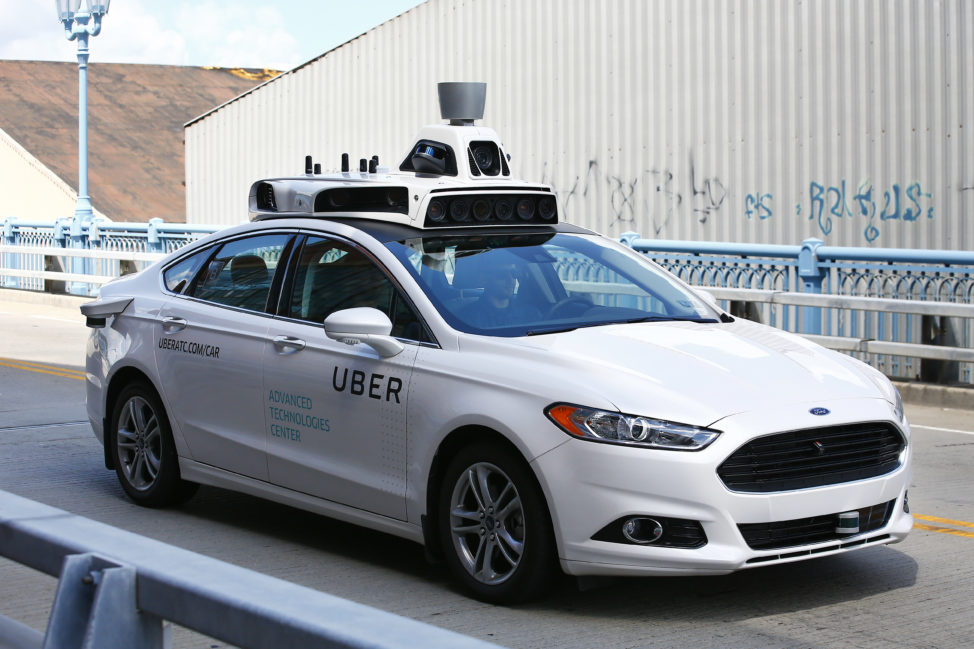 Another step towards driverless cars. Here Uber employees test the self-driving Ford Fusion hybrid cars in Pittsburgh, Pa on 8/18/16. (AP)