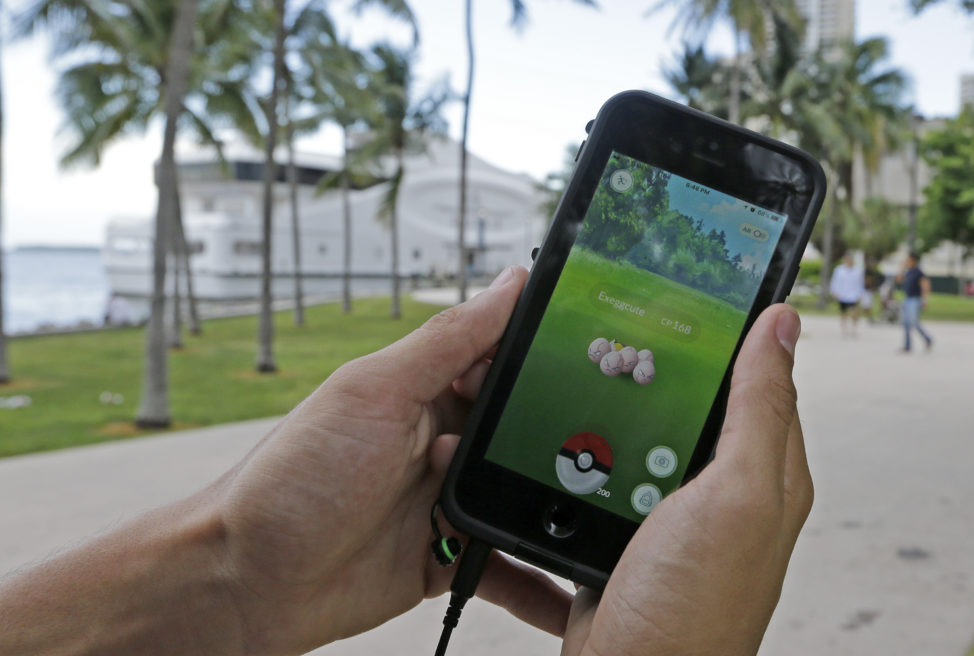 Pokemon Go the smartphone game application released on 7/6/16 has already become a worldwide phenomenon. Here a Pokemon Go player finds Exeggcute, a Pokemon, at Bayfront Park in Miami, FL on 7/12/16. (AP)
