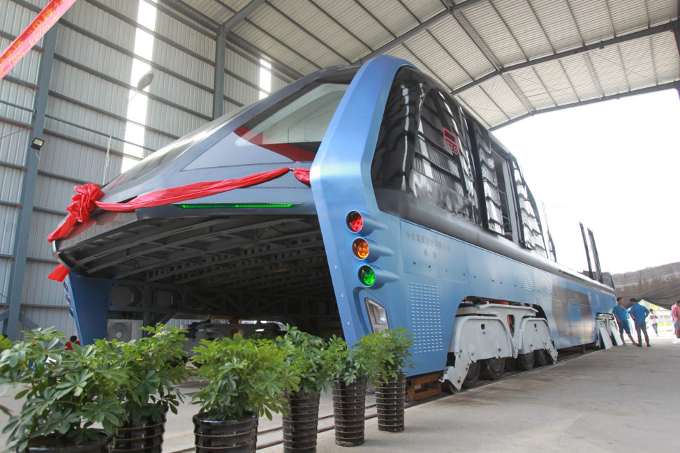 A model of an innovative street-straddling bus called Transit Elevated Bus is seen after a test run in Hebei Province, China, 8/3/16. According to local media this test is capable of carrying 300 people (Reuters)