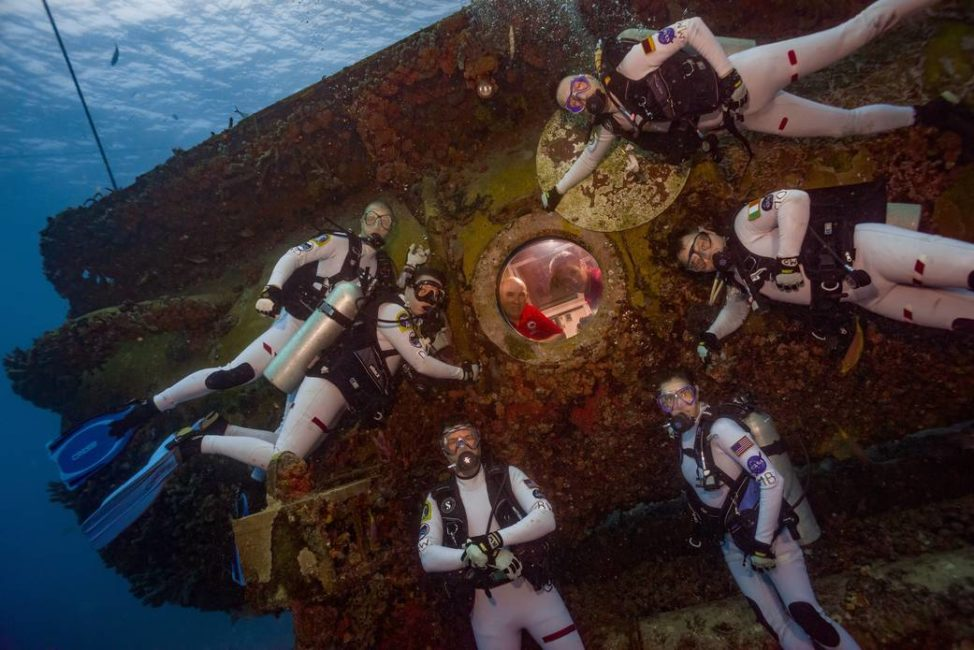 Here are the aquanauts of NASA's Extreme Environment Mission Operations (NEEMO) 21 mission, which began on 7/21/16. The 16 day simulated space mission is being held at the Aquarius Reef Base, located nearly 19 meters below the surface of the Atlantic Ocean in the Florida Keys National Marine Sanctuary. The purpose of the mission is to evaluate tools and mission operation techniques that could be used in future space missions. (NASA/Karl Shreeves)