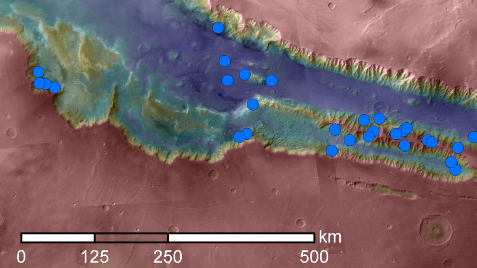 (Blue dots on this map indicate sites of recurring slope lineae (RSL) in part of the Valles Marineris canyon network on Mars. RSL are seasonal dark streaks that may be indicators of liquid water. The area mapped here has the highest density of known RSL on Mars. (NASA/JPL-Caltech/Univ. of Arizona)