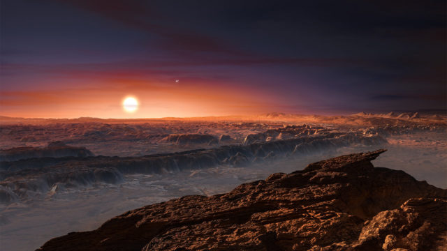 Artist's impression of the surface of the exoplanet Proxima Centauri b orbiting the red dwarf star Proxima Centauri, the closest star to our solar system. You can also see the better known double star Alpha Centauri AB in the image. Astronomers at the European Southern Observatory announced the discovery of the exoplanet, which is only 4.2 light years away from Earth on 8/24/16. The planet orbits its star within the habitable zone, where the temperature is said to be suitable for liquid water to exist on its surface. (ESO/M. Kornmesser)