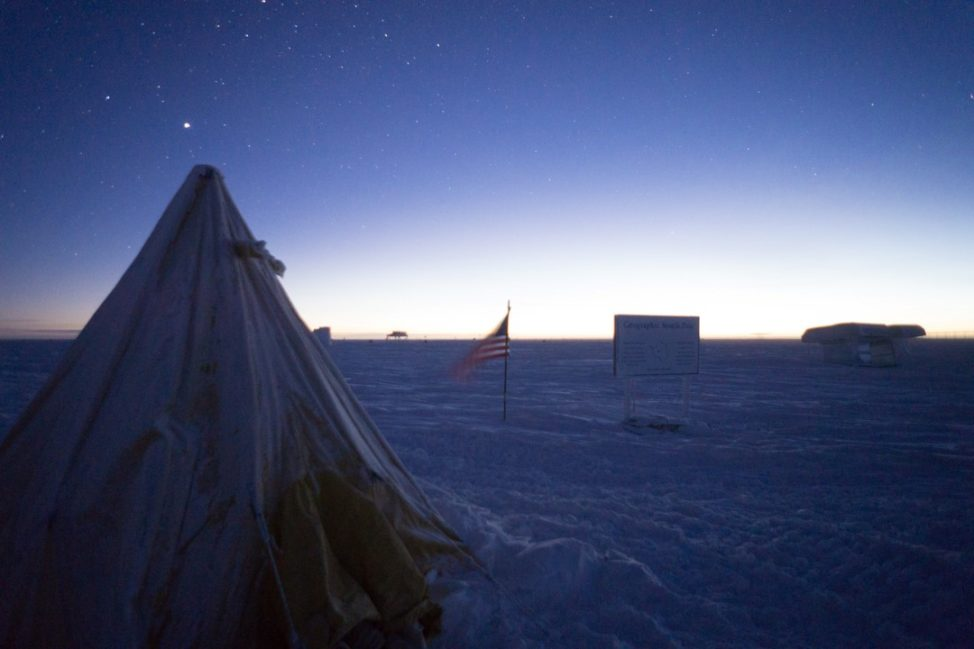 In celebration of the rising sun, a tent similar to the ones used on the original Scott expedition has been erected near the geographic pole. It is a good place to escape the wind and observe the receding night sky. (Photo: Max Peters)