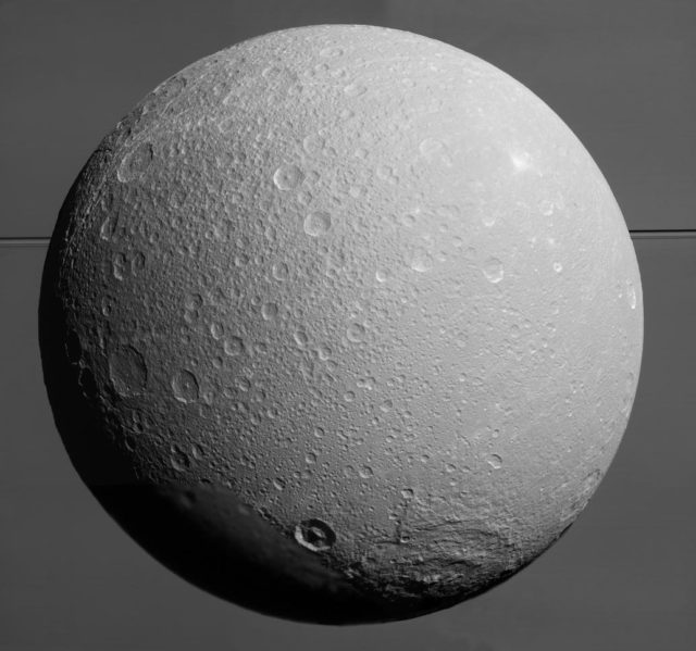 Dione with Saturn and its rings in the background. This image was taken by the Cassini spacecraft on 08/17/15 (NASA/JPL-Caltech/Space Science Institute)