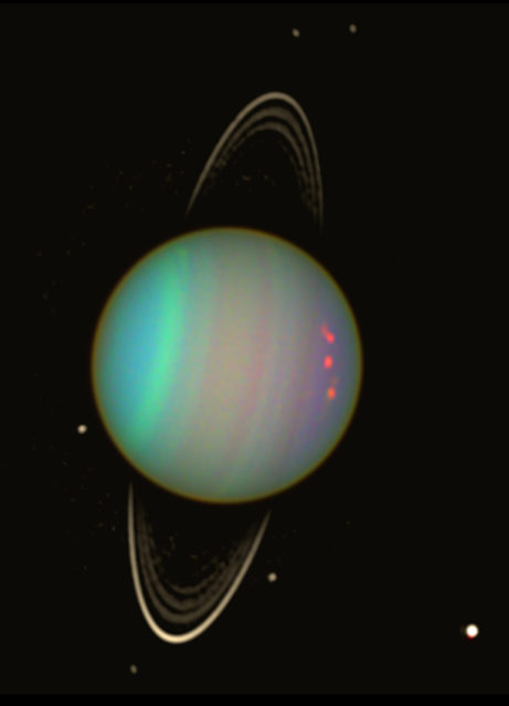 Uranus is seen in this false-color view from NASA's Hubble Space Telescope from August 2003. The brightness of the planet's faint rings and dark moons has been enhanced for visibility. (NASA/Erich Karkoschka (Univ. Arizona))