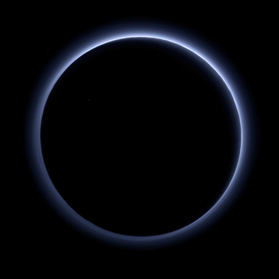 NASA released this image showing a haze layer encircling Pluto on 10/08/16. The planet was photographed by the New Horizons spacecraft's during its July 14, 2015 flyby. Using a variety of near-infrared observational information, the image was created with special software to look as close to how a human eye would see it. (NASA/JHUAPL/SwRI via AP)
