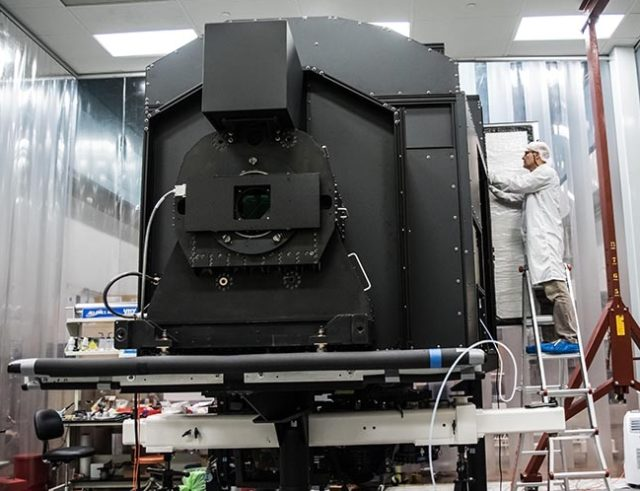 Hector Rodriguez, senior mechanical technician, works on the Keck Cosmic Web Imager in a clean room at Caltech. (Caltech)