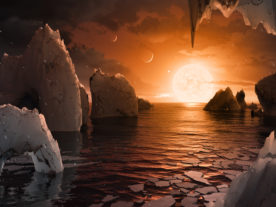 This illustration shows the possible surface of TRAPPIST-1f, one of the newly discovered planets in the TRAPPIST-1 system. (NASA/JPL-Caltech)