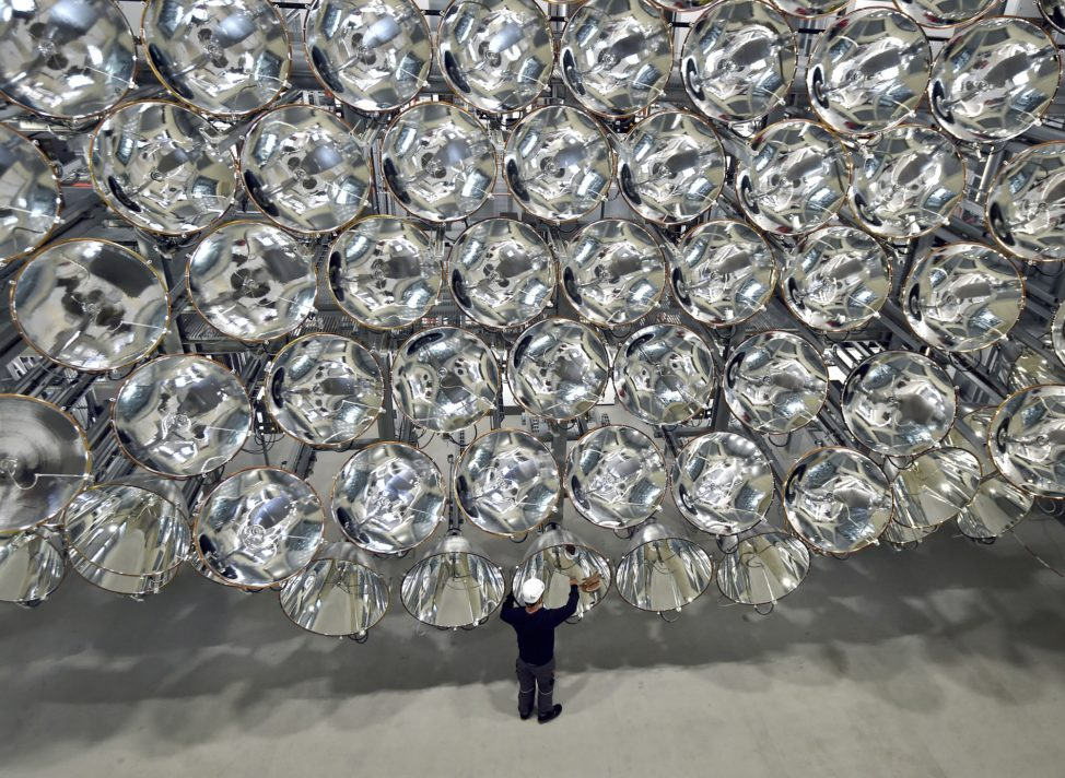 Engineer Volkmar Dohmen stands in front of a giant bank of xenon short-arc lamps at the DLR German national aeronautics and space research center in Germany. When switched on, what is being called the world's largest artificial sun creates combined intensity that's 10,000x stronger than sun's light on Earth's surface and produces temperatures of around 2,982° Celsius. The photo was taken on 3/21/17 (AP)