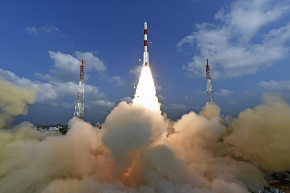 This photograph released by Indian Space Research Organization shows its polar satellite launch vehicle lifting off from a launch pad on 2/15/17. The Indian space agency sent a record 104 satellites on single rocket into space. (Indian Space Research Organization via AP)
