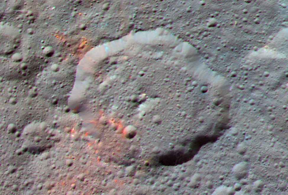 NASA's Dawn spacecraft snapped this enhanced color composite image of an area around the Ernutet crater on the dwarf planet Ceres. Dawn scientists say that the red areas in this photo, released 2/16/17 could be evidence of organic material. (NASA/JPL-Caltech/UCLA/MPS/DLR/IDA)