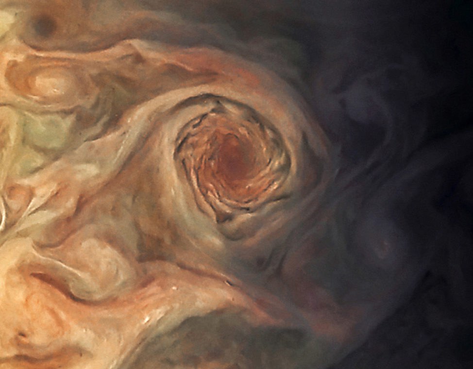 This image, taken on 3/27/17, by the JunoCam imager on NASA's Juno spacecraft, focuses on a swirling storm just south of one of the white oval storms on Jupiter. NASA says at the time the image was taken, the spacecraft was about 20,000 kilometers from the planet. (NASA/JPL-Caltech/SwRI/MSSS/Jason Major)