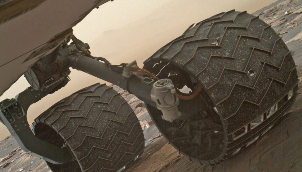 Two of the raised treads on the left middle wheel of NASA's Curiosity Mars rover broke during the first quarter of 2017. You can especially see one that's partially detached at the top of the wheel. The photo was taken 3/19/17 with the Mars Hand Lens Imager (MAHLI) camera that's attached to on the rover's arm. (NASA/JPL-Caltech/MSSS)