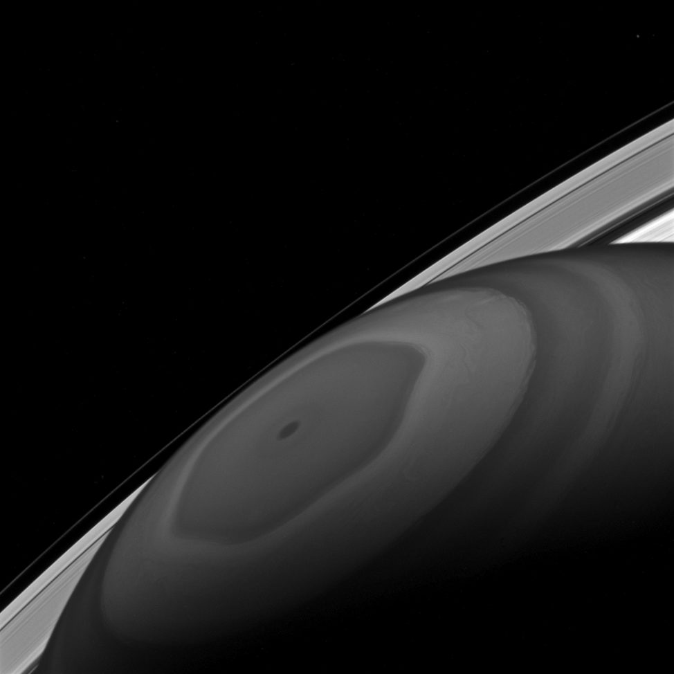 NASA's Cassini spacecraft got this image of Saturn's North Pole. You can see clouds churning around it driven by the fast winds of the ringed planet. You can also see some of the planet's moons and small particles that form its ring. (NASA/JPL-Caltech/Space Science Institute)